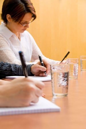business people writing in a meeting room Stock Photo - 885339