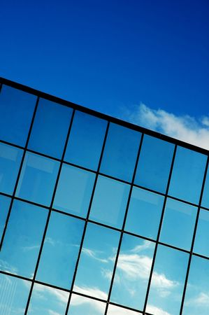 Reflected blue sunny sky in a modern glass building Stock Photo - 910751