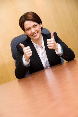 happy business woman in a boardroom table Stock Photo