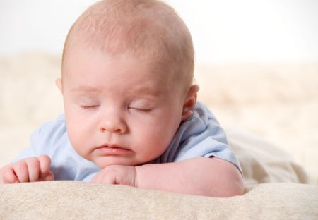 new born baby dosing off during a shoot
