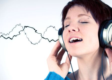 female happy is listening to music with headphones