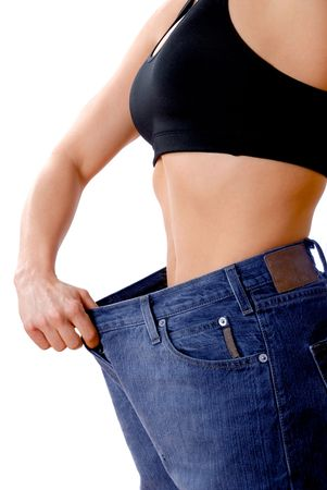 female wearing old jeans who has lost weight Stock Photo - 930242
