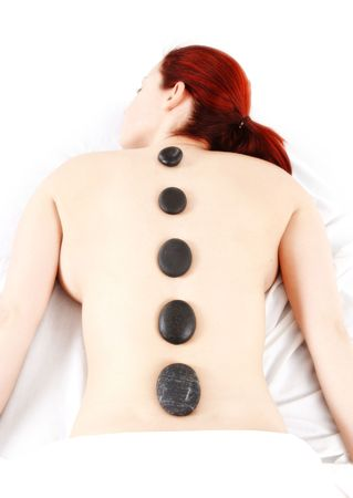 woman getting a hot stone massage treatment photo