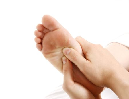 a foot massage given by a therapist in a spa Stock Photo