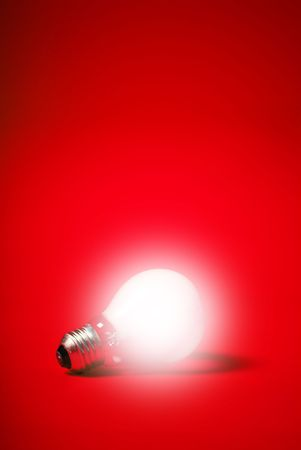 incandescent light bulb on a red background