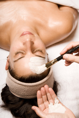 facial muscles: woman relaxing with a nice facial massage