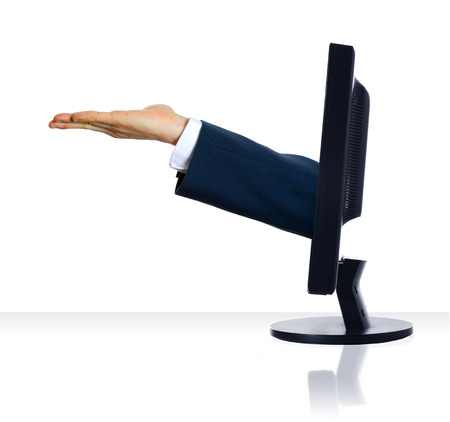 technology transaction: an empty hand sticking out of a monitor