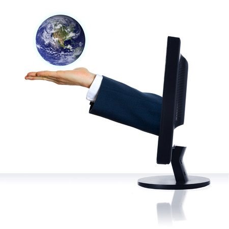 technology transaction: A hand from a monitor holding a planet