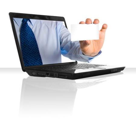 businesscard: A hand giving a businesscard through a laptop