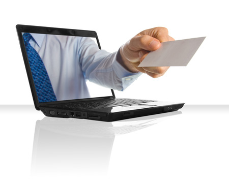 a hand sticking through a laptop giving a card Stock Photo - 1449342