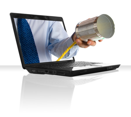 a hand giving a tin can phone through a laptop
