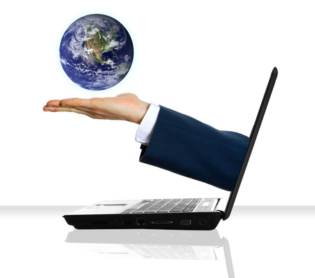 technology transaction: a hand holding a planet from a laptop