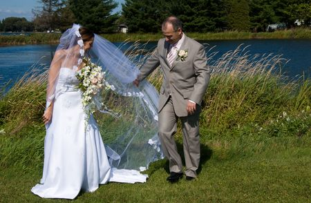 mariage: a just married man and woman by a lake