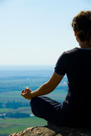 newage: Woman on the top of a mountain meditation