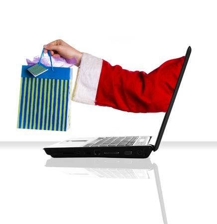 a single laptop on a white table and background xmas photo
