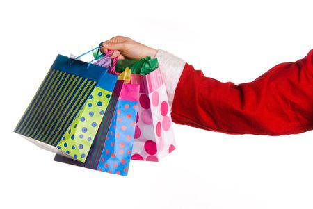 santa clause handing over some nice gifts Stock Photo