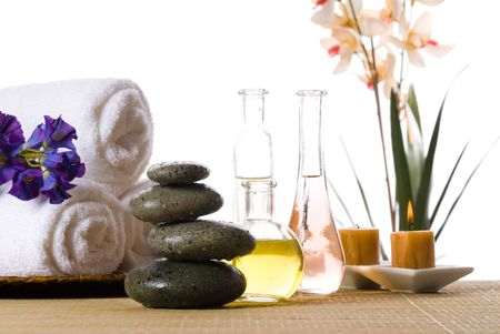 spa products with stones towels flasks and oil Stock Photo