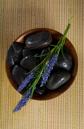 bowl of hot stones for lastone massage