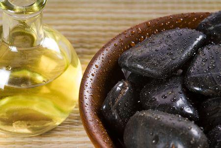 lastone: bowl of hot stones for lastone massage