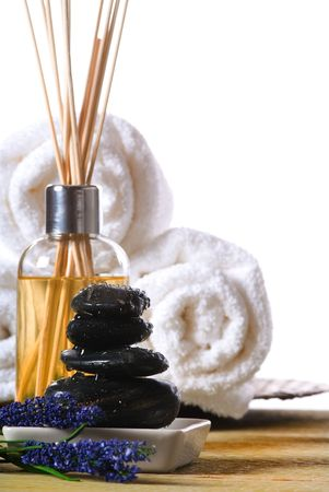 massage stones and towels spa tools and oil photo