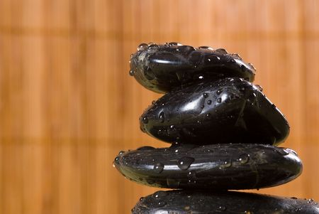 stack of hot stones for lastone massage