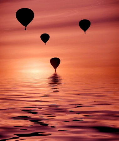 balloons at sunset with a water reflection photo