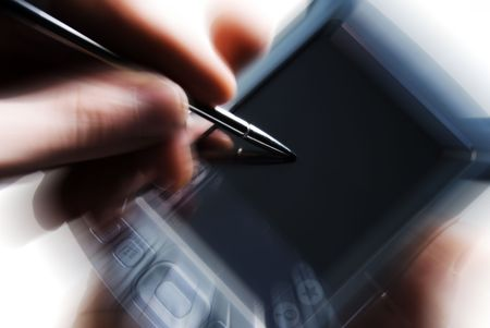 writing an email on PDA with blur action Stock Photo - 2074715