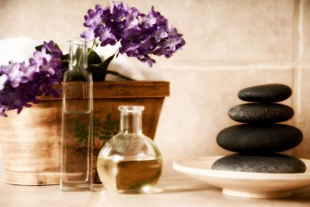 day spa products with stones, oil container, flowers Stock Photo - 2074711