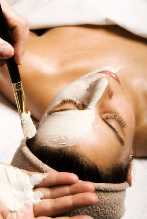 day spa: woman getting a facial at a day spa Stock Photo