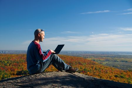 getting away from it all on the laptop in nature Stock Photo - 2150358