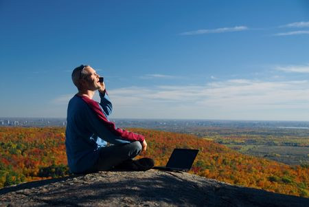 getting away from it all: getting away from it all on the laptop in nature Stock Photo