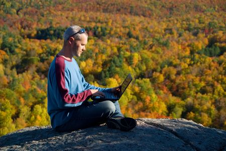 away from it all: getting away from it all on the laptop in nature Stock Photo