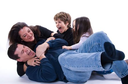 mom and dad with siblings on a white Stock Photo - 2427436