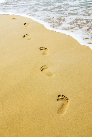 footprint: foot steps on the beach in the tropics Stock Photo