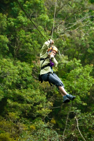 zip: woman on a zip line in panama canopy Stock Photo