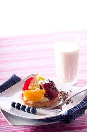 Fruit Tart on a white plate on a table photo