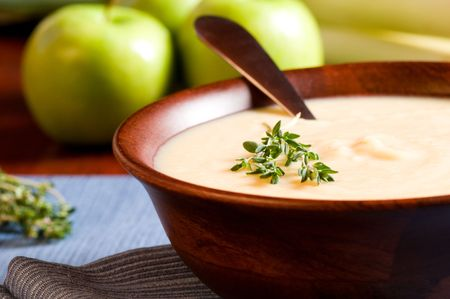 leeks: Apple and Leek Soup on a rustic table Stock Photo