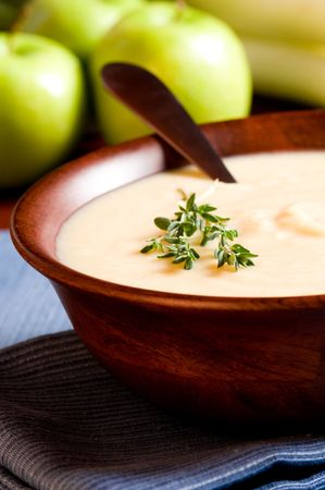 entrees: Apple and Leek Soup on a rustic table Stock Photo