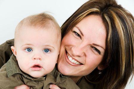 mom happy with their baby boy blue eyes photo