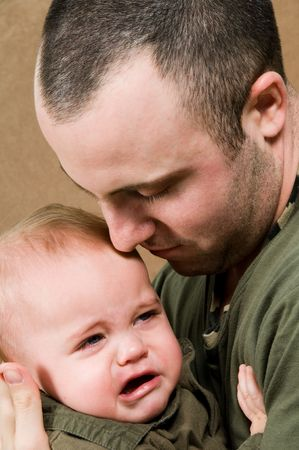 boy crying: father with his young baby boy son Stock Photo