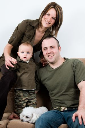 mom and dad on a sofa with their baby boy Stock Photo - 2701570