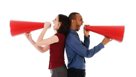 two business people on isolated white with red megaphones Imagens
