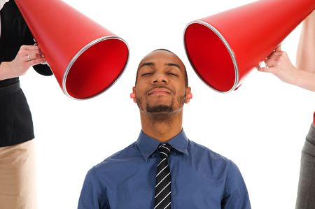 harass: business people with megaphone harrassing colleague