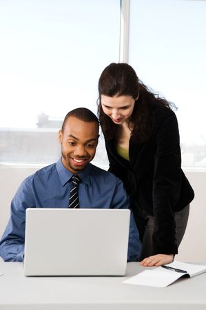 male and female business partners in a window office Stock Photo - 2778438