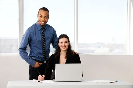 male and female business partners in a window office Stock Photo - 2778437