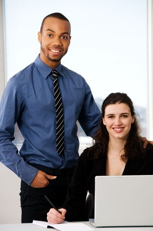 male and female business partners in a window office photo