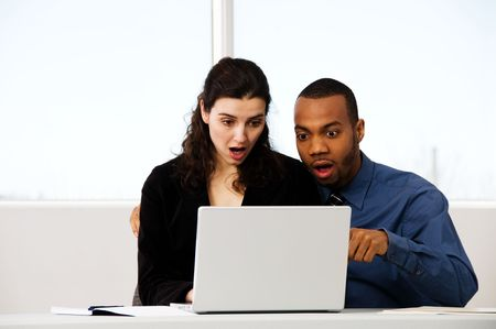 male and female business partners in a window office Stock Photo - 2778434