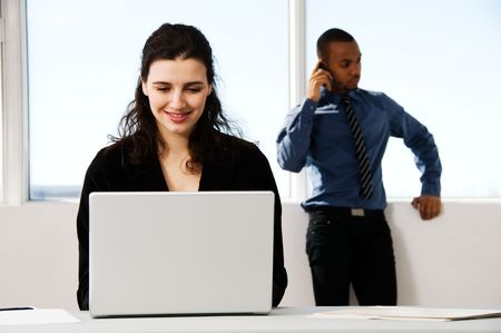 male and female business partners in a window office Stock Photo - 2778440