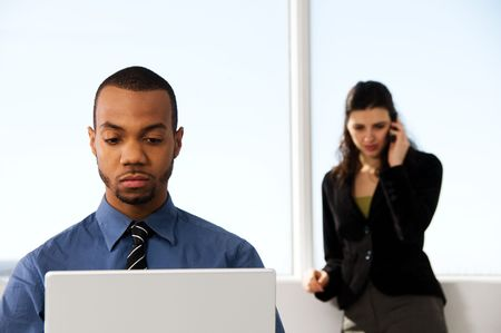 male and female business partners in a window office Stock Photo - 2778424