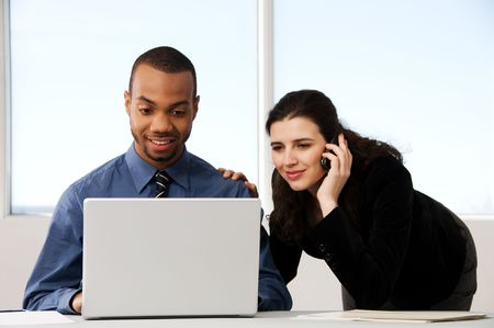 male and female business partners in a window office Stock Photo - 2778439